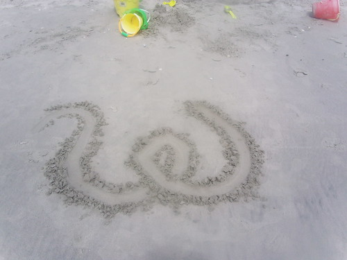 Curly W in sand