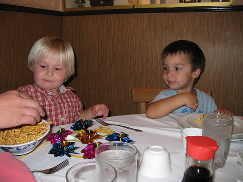 Finn and Thomas await dinner at Yang Chow