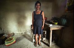 Woman in Her Home (Andrew J. Tonn) Tags: poverty leica portrait woman film latinamerica poor mother documentary honduras centralamerica filmscan honduran focal bluedress scannedfilm leicam6ttl 50mmsummicron andrewtonn focalfilm