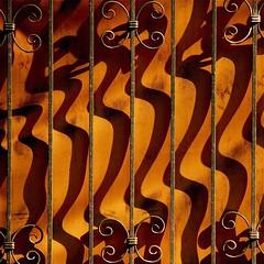 Kaum hrbar (Postsumptio) Tags: shadow orange building vertical fence iron geometry line material singlecolor