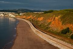Dawlish Railway Sea Wall (willumhg) Tags: uk sea summer sunrise dawn seaside sony cliffs devon warren a200 dawlish langstonerock sonya200