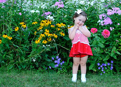 Cutie (Narfas) Tags: pink flowers red summer plants white color green girl smile grass yellow socks youth fun photo nikon shoes child dress purple legs sweet blueeyes joy young posing cutie bow innocence chubby cockedhead d80 capturenx2 gettyvacation2010