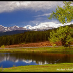 Pond at Aspen Lodge Ranch Resort with view of Longs Peak