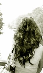 Facing the river (Andrews-Photography) Tags: people blackandwhite woman monochrome sepia female river hair bag bedford back unitedkingdom bokeh bedfordshire 2010 canon500d ボケ bokehlicious flickraward canoneos500d bedforduk bedfordembankment