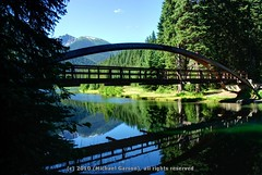 Rainbow Bridge at Lightning Lake (Michael Garson) Tags: bridge trees mountain lake canada mountains reflection tree green nature water beauty forest reflections nikon arch walk exploring columbia hike british exploration