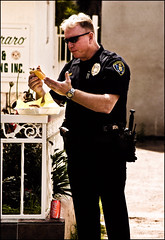 No Napkin (Bosquet) Tags: california street blue light portrait people sun sunlight man streets sunshine sunglasses lunch person hands nikon uniform mess break cops sandiego drink eating candid character burger duty authority fingers police coke pd can pop dirty sd eat badge messy blonde daytime subject soda cocacola southerncalifornia 80 officer sdpd d80 nikond80