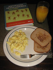 Scrambled eggs, buttered toast with cinnamon, and OJ