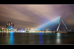 Erasmusbrug Rotterdam (DolliaSH) Tags: city longexposure bridge light urban haven holland color water colors architecture night canon reflections river puente photography lights noche photo rotterdam topf50 europe foto nightshot photos nacht harbour nederland thenetherlands ponte most le pont brug maas topf150 brcke topf100 frontpage nuit kopvanzuid notte topf200 stad erasmusbrug noch zuidholland brucke canonefs1022mmf3545usm southholland 3000views explored nachtopname visitholland canoneos50d dollia dollias sheombar ersmusbrug dolliash aboveandbeyondlevel1