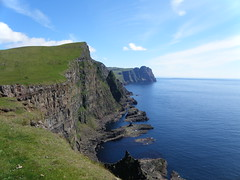 Faroe Islands Cliffs - Eggjarnar - The Cliffs of Vgur, Suuroy, Froyar (Eileen Sand) Tags: ocean travel sea summer cliff seascape mountains nature landscape coast view photos cliffs atlantic explore coastline juli seashore faroeislands myndir 2010 northatlantic summar faroes landslag froyar frarna fryene freyjar faeroes frerne faeroe explored faroese frer suuroy foroyar beinisvr vgur rockyseashore july2010 suduroy lesfro isolefaroe skvanes tvran isolefrer beinisvord eggjarnar fjll eileensand  islandjumping cliffsofsuduroy cliffsofsumba cliffsofbeinisvr cliffsofvgur cliffsoflopra cliffsofsuuroy cliffsofthefaroeislands spinarnir westcliffsofsuduroy