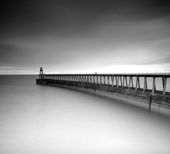 Whitby Pier in black and white (Semi-detached) Tags: sea bw white seascape black clouds pier seaside nikon long exposure yorkshire north fast august 09 lee whitby nd grad 2010 yorks semidetached nd1000 nd110