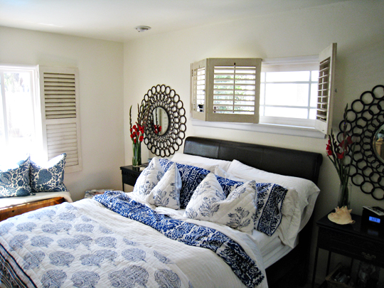 master bedroom+circles mirrors+blue and white mixed floral prints