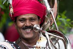 The smile of kings.... (GlasgowPhotoMan) Tags: rajasthan india landofkings musician rajasthanheritagebrassband brassband sousaphone music performer glasgow glasgowmela mela kelvingrovepark glasgowwestend scotland asianfestival arts culture