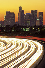 Los Angeles Highway 10 with skyline (Jim Corwin's PhotoStream) Tags: travel windows sunset signs motion blur cars tourism vertical skyline architecture speed buildings outdoors photography evening la twilight highway cityscape skyscrapers traffic dusk sightseeing scenic citylife visit headlights tourists illuminated timeexposure financialdistrict business transportation citylights northamerica tall rushhour local lighttrails roads jam overlooking vacations trafficsigns taillights attractions destinations motorvehicles urbanscene famousplace placestosee cityoflosangeles downtowndistrict multiplelanehighway