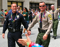 Men in Uniform Holding Hands at the Pride Parade (stormdog42) Tags: gay urban chicago march illinois crowd police pride parade lgbt holdinghands