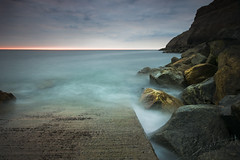Whitby Rocks #1 (Dave Brightwell) Tags: longexposure sea seascape beach landscape seaside rocks waves sony sigma whitby 1020mm ndgrad a550 bwnd