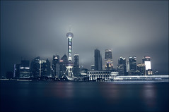 Steel city (digitalgopher) Tags: china longexposure nightphotography reflection water skyline skyscraper buildings river haze nikon ship shanghai cloudy rainy 1855mm oriental pudong bund tvtower huangpu orientalpearltower ligths d300