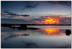 fireball (Soumya Bandyopadhyay) Tags: sunset lake reflection water rural landscape dusk wide bengal westbengal gradnd pentaxk200d pentax1855mmii
