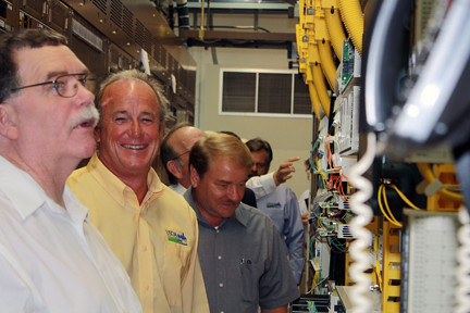 Fentress County Mayor John Mullinix, RD State Director Bobby Goode, and Clay County Mayor Dale Reagan view Twin Lakes telephone Co-op's main switching facility in Jamestown.