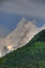 Cloudy peak (KOKONIS) Tags: travel mountain france alps clouds forest alpes landscape nikon europa europe chamonix rhnealpes d80 mrgniqq
