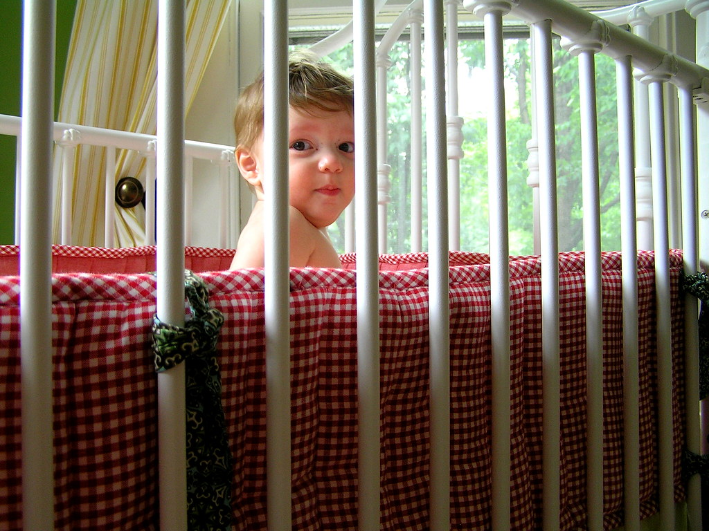 a boy in his crib
