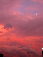 Sunset with the Moon- July 20, 2010 (Just_Bernard) Tags: sunset red storm clouds brilliant
