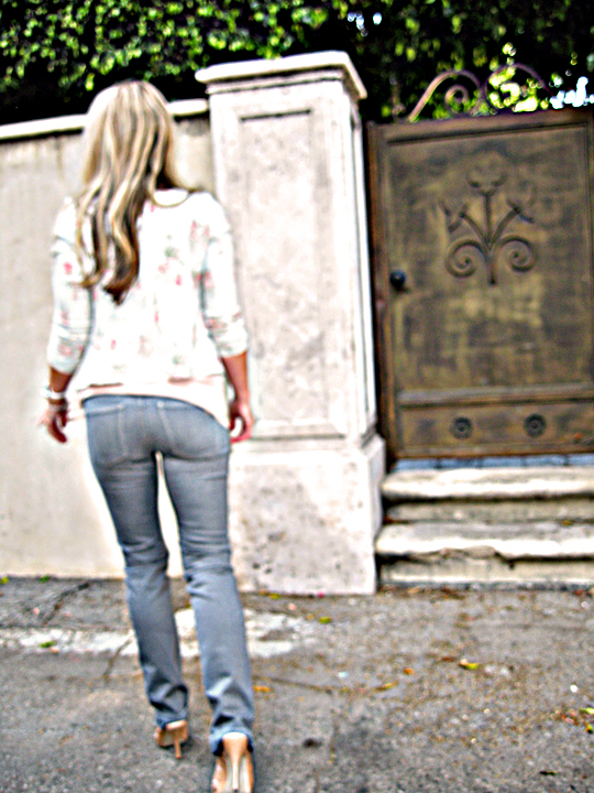gray jeans from behind+floral blazer+walking off+photo