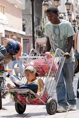 Child Transport (vinylmeister) Tags: girls people june children photography dominicanrepublic year cities malecon santodomingo 2010 photocamera nikond700 nikonafnikkor85mmf14dif