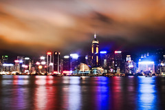 Colors of Hong Kong (Jim Boud) Tags: ocean china camera longexposure travel pink light red sky orange mountain seascape black reflection building tower skyline clouds skyscraper canon lens landscape asian island hongkong eos prime shiny colorful asia cityscape shine nightshot pacific bright cloudy dusk smooth styles fixed 24mm dslr digitalrebel photoart digitalslr f28 ef hongkongisland waterscape nightexposure slowshutterspeed artisticphotography partlycloudy victoriaharbour victoriaharbor asiapacific t2i eos550d kissx4