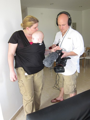 Christine and Drew set up the video camera, while baby Cole hangs out.