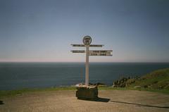 Land's End (ponyintheair) Tags: uk blue red sea england sky sign cornwall horizon landsend swimmers olympusxa expiredfilm 400h