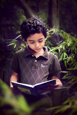 SAIF (irfan cheema...) Tags: boy portrait texture garden reading book kid shanghai son saif irfancheema