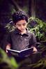 SAIF (irfan cheema...) Tags: boy portrait texture garden reading book kid shanghai son saif irfancheema