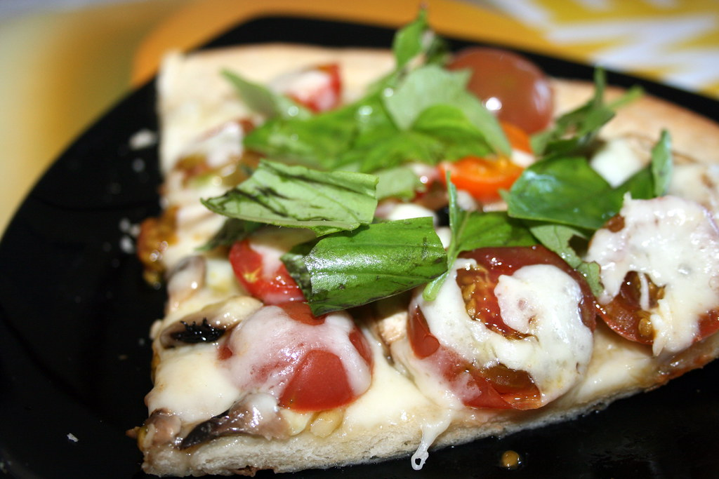 Mushroom, heirloom tomato and basil pizza
