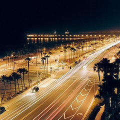 Huntington Beach (Bright Lights, Vegas Nights) Tags: 120 6x6 film beach night mediumformat square balcony hasselblad squareformat lighttrails huntingtonbeach traffictrails hasselblad500cm kodakportra160nc carlzeissplanar80mmf28 autaut sekonicl308s hiltonwaterfront