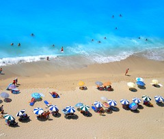 Egremni beach, Lefkada (Greece) - August 2010 (PattyK.) Tags: trip travel blue sea summer vacation sun colour beach island sand europa europe mediterranean colours view hellas eu august greece grecia tropical umbrellas griechenland europeanunion grece ioniansea deepblue ellada egremni ionio lefkada tropicalbeach greekisland  deepbluesea     mediterranenasea pelagos eptanisa   egremnoi ionionpelagos summeringreece    greeksummer leftas            egremnibeach
