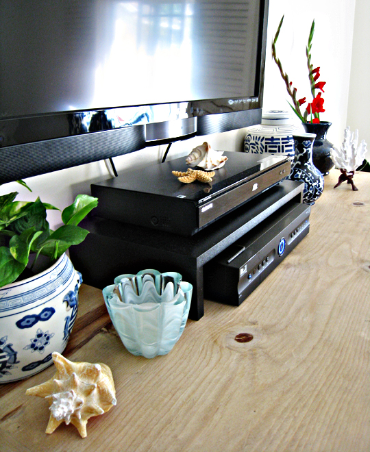 mounted flat screen+blue and white accents+shells accents+beach decor+rustic dresser