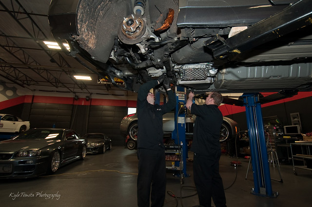Russ Weimer and Gary Rayevich installing the transmission and read subframe on a 2010 Nissan GT-R