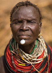 Portrait of an old Nyangatom tribe woman in a village with a chin decoration, Omo Valley, Kangate, Ethiopia (Eric Lafforgue) Tags: adult africa anthropology beaded beads beautifulpeople blackpeople bodymodification bume chin closeup day decoration developingcountry eastafrica ethiopia ethiopia0617267 ethiopian feminine headshot hornofafrica indigenousculture jewel jewelry kangate labret lookingatcamera markings necklaces nyangatom omovalley oneperson onewomanonly ornament ornamentation outdoors pattern portrait scarifications scars traditionalclothing tribal tribe tribeswoman vertical women et