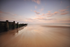 CONVERGENCE (Michael Halliday) Tags: uk longexposure sunset sea seascape beach clouds reflections sand nikon northumberland blyth groynes bythesea d90 sigma1020 10stop