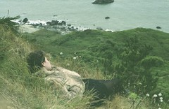 (genevive bjargardttir) Tags: ocean sea summer cliff cold film water girl grass analog 35mm iso800 fuji pacific july furcoat landsend praktica npz mtl3 genevivebjargardttir