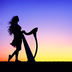 Sarah Marie Mullen Sunset Silhouette (gbrummett) Tags: blue sunset musician music hot sexy colors silhouette yellow sunrise cool fantastic colorful purple fantasy harp favs sarahmariemullen flickraward canonef85mmf12liiusmlens canon5dmarkiicamera celticharpist arizona2010renaissancefestival