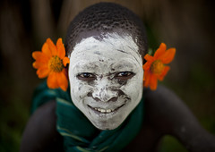 Surma boy with flowers - Ethiopia (Eric Lafforgue) Tags: boy portrait fleur smile face child artistic culture makeup bodylanguage tribal ornament tribes bodypainting tradition tribe ethnic rite sourire surma tribo visage adornment pigments ethnology tribu omo eastafrica thiopien suri etiopia ethiopie etiopa 1394  etiopija ethnie ethiopi  etiopien etipia  etiyopya  snnpr nomadicpeople      tulgit    southernnationsnationalitiesandpeoplesregion turgit peoplesoftheomovalley