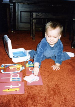 "Will (1 1/2) playing the ""fun"" game with objects from his medical kit in 1986."
