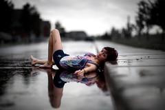 . (Dan. D.) Tags: road portrait bw woman color reflection wet water girl rain delete10 canon delete9 concrete delete5 delete2 delete6 delete7 perspective young 85mm save3 delete8 delete3 delete delete4 save save2 line explore ii 5d frontpage mk f12 deletedbydeletemeuncensored