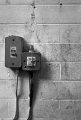 Fuse Box - The unfortunate necessity of light (Alex_Bates_Photography) Tags: light urban white black building brick abandoned glass wall vintage grey nikon box dirty grip exploration derelict fiddy ambiguous mil fuse fifty necessity sockets d40 nonmetering whataretheyreallyinigmas