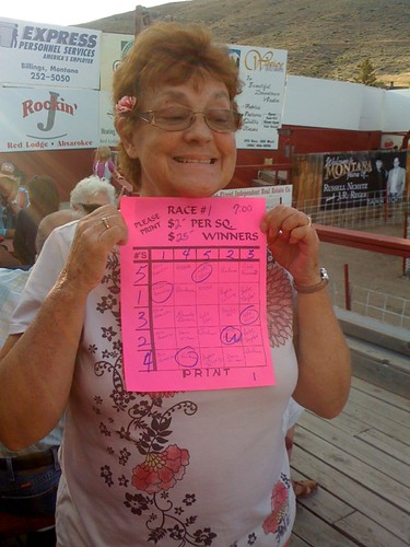 Carol was the lucky one in the first race with the fleet footed Louie Luau pig - winings . . . $25 on a $2 bet.