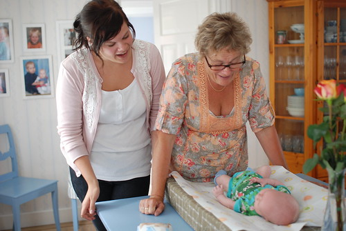 Grandmother Kerstin and aunt Moa taking changing diapers