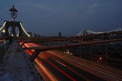 Brooklyn Bridge (Christopher Wallace) Tags: city nyc newyorkcity nightphotography bridge light ny newyork cars brooklyn night river timelapse nikon dusk manhattan d70s wideangle vehicles brooklynbridge manhattanbridge streaks nightfall superwideangle ultrawideangle 14mm