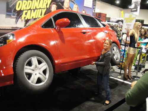 Comic-Con 2010 - No Ordinary Family booth - little girl picks up a car