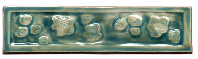 hand made liner tile with cherry blossoms hand carved, inspired by japanese wood block print, glaze in jade green, turquoise